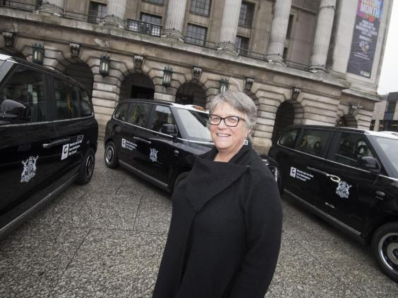 Councillor Sally Longford with Nottingham's electrified taxi fleet (Nottingham City Council)