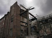 <p>Metal beams protrude from the ruins of a collapsed industrial plant. </p>