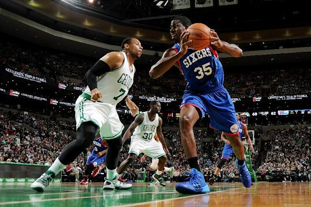 BOSTON, MA - APRIL 4: Henry Sims #35 of the Philadelphia 76ers drives the ball against Jared Sullinger #7 of the Boston Celtics on April 4, 2014 at the TD Garden in Boston, Massachusetts. (Photo by Brian Babineau/NBAE via Getty Images)