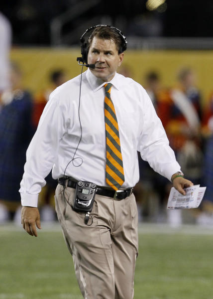 FILE - In this Oct. 6, 2012, file photo, Miami head coach Al Golden appears during the first half of an NCAA college football game against Notre Dame at Soldier Field in Chicago. Golden's crisp white dress shirt and a sharp orange tie make him arguably the best dressed coach in the college game. He played for the late Joe Paterno at Penn State, himself one of the last throwbacks to the jacket-and-tie set. (AP Photo/Charles Rex Arbogast, File)