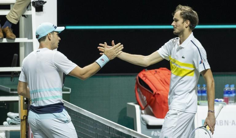 Daniil Medvedev (R) congratulates Serbia's Dusan Lajovic (L) after losing in the first round in Rotterdam with an error-strewn display
