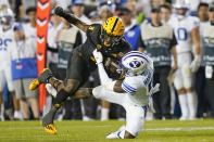 BYU defensive back D'Angelo Mandell (5) tackles Arizona State running back Rachaad White (3) in the second half during an NCAA college football game Saturday, Sept. 18, 2021, in Provo, Utah. (AP Photo/Rick Bowmer)
