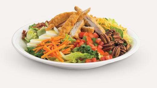 """<p>Features garden greens mixed with ranch dressing and topped with bacon, breaded chicken breast fillet, pecans, mozzarella, cheddar, chopped egg, carrots and diced tomato. This salad tops our list with a <strong>staggering 88 grams of fat, 1,170 calories and 1,550 mg of sodium</strong> (without sides or dips).<br><br><strong>Serving size: 659 g (full order) </strong><br> — Calories: 1,170<br> — Fat: 88 g (Saturated Fat 15 g)<br> — Carbohydrates: 46 g<br> — Sodium: 1,550 mg<br> — Sugar: 15 g<br> — Protein: 53 g<br> — Source/Photo: <a href=""""https://bostonpizza.com/en/nutrition/information/salads"""" rel=""""nofollow noopener"""" target=""""_blank"""" data-ylk=""""slk:Boston Pizza"""" class=""""link rapid-noclick-resp"""">Boston Pizza<br></a><br><strong>TRY THIS INSTEAD:</strong> Boston Pizza House Chicken Salad. (Fat: 16 g/Sat. Fat 2 g/Sodium: 1,350 mg) The chicken salad has significantly less fat (16 g) and more protein (59 g) than the chicken pecan salad, but it's still packed with sodium (1,350 mg). </p>"""