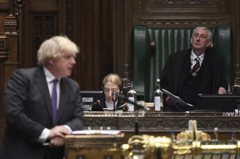 In this handout photo provided by UK Parliament, Speaker of the House of Commons Lindsay Hoyle looks on as Britain's Prime Minister Boris Johnson speaks, during Prime Minister's Questions in the House of Commons, London, Wednesday, June 24, 2020. (Jessica Taylor/UK Parliament via AP)