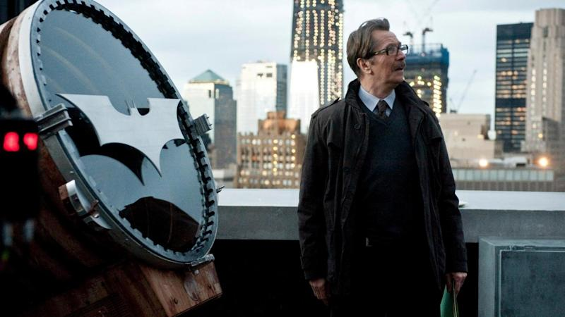 Gary Oldman in front of the Bat signal