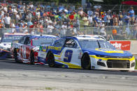 Chase Elliott (9) leads a group during a NASCAR Cup Series auto race Sunday, July 4, 2021, at Road America in Elkhart Lake, Wis. (AP Photo/Jeffrey Phelps)