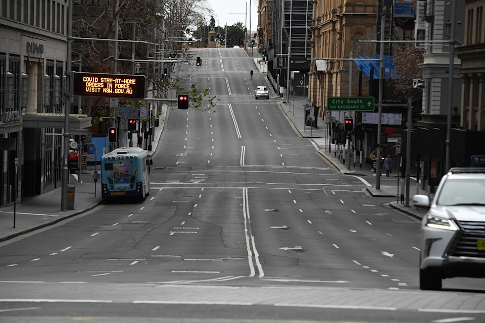 An empty Bridge St is seen in the central business district in Sydneyy, Wednesday, July 21, 2021. The stay-at-home orders for coronavirus-hit Greater Sydney and surrounds have been tightened with non-essential retail to close and all construction paused until July 30.