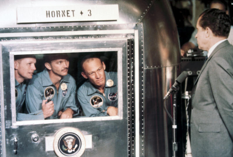 UNITED STATES - MAY 21: Astronauts, Neil Armstrong, Edwin �Buzz� Aldrin and Michael Collins are welcomed aboard the USS Hornet by President Richard Nixon. The astronauts are in a Mobile Quarantine Facility. Apollo 11, the first manned lunar landing mission, was launched on 16th July 1969 and Neil Armstrong and Aldrin became the first and second men to walk on the Moon on 20th July 1969. Command Module pilot Michael Collins remained in lunar orbit while Armstrong and Aldrin were on the surface. The astronauts returned to Earth on 24th July 1969. (Photo by SSPL/Getty Images)