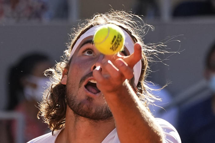 Stefanos Tsitsipas of Greece serves the ball to Serbia's Novak Djokovic during their final match of the French Open tennis tournament at the Roland Garros stadium Sunday, June 13, 2021 in Paris. (AP Photo/Michel Euler)