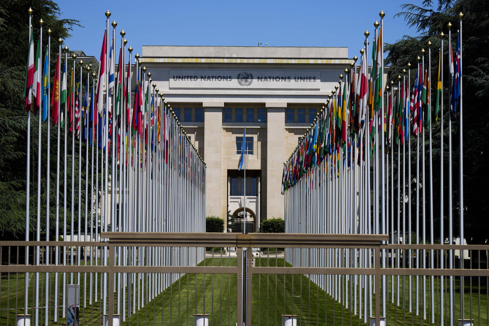 Flagpoles line in rows in front of a building of the United Nations in Geneva, Switzerland Monday, June 14, 2021. The lakeside city known as a Cold War crossroads and a hub for Swiss discretion, neutrality and humanitarianism, is set to return to a spotlight on the world stage as U.S. President Joe Biden and Russian President Vladimir Putin come to town for a summit on Wednesday, June 16.(AP Photo/Markus Schreiber)