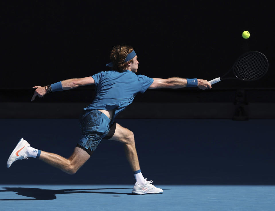 Russia's Andrey Rublev hits a backhand to Norway's Casper Ruud during their fourth round match at the Australian Open tennis championships in Melbourne, Australia, Monday, Feb. 15, 2021. (AP Photo/Hamish Blair)
