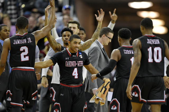 Gardner-Webb's bench reacts after a play against Virginia during a first-round game in the NCAA mens college basketball tournament in Columbia, S.C., Friday, March 22, 2019. (AP Photo/Richard Shiro)
