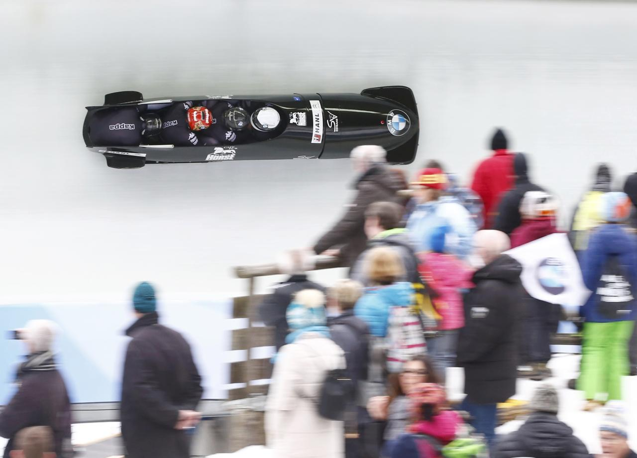 Bobsleigh - BMW IBSF Bob & Skeleton World Championships - 4-men third race - Koenigssee, Germany - 26/2/17 - Markus Treichl, Markus Glueck, Kilian Walch and Franz Esterhammer of Austria in action.      REUTERS/Arnd Wiegmann