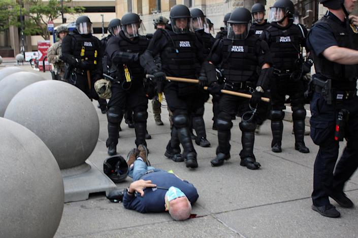Martin Gugino, a 75-year-old protester, lies on the ground after he was shoved by two Buffalo police officers during a protest on Thursday. (Jamie Quinn via Reuters)