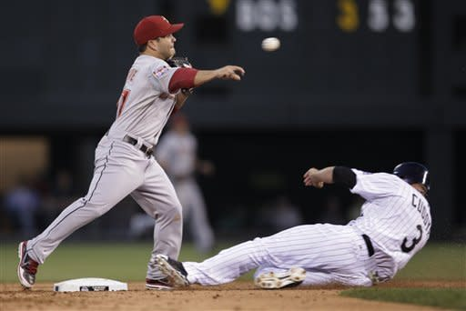 Houston Astros second baseman Jose Altuve, left, forces out Colorado Rockies' Michael Cuddyer, right, and throws to first on an attempted double play in the fourth inning of a baseball game on Thursday, May 31, 2012, in Denver. Rockies baserunner DJ LeMahieu was safe at first. (AP Photo/Joe Mahoney)