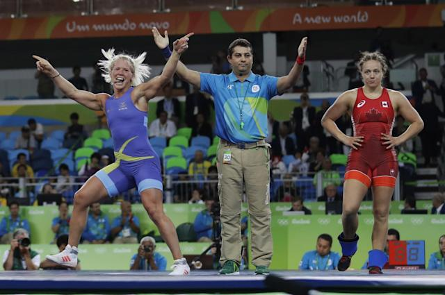 <p>Sweden's Anna Jenny Fransson, left, celebrates after beating Canada's Dorothy Erzsebet Yeats in the women's wrestling freestyle 69-kg competition bronze medal round at the 2016 Summer Olympics in Rio de Janeiro, Brazil, Wednesday, Aug. 17, 2016. (AP Photo/Markus Schreiber) </p>