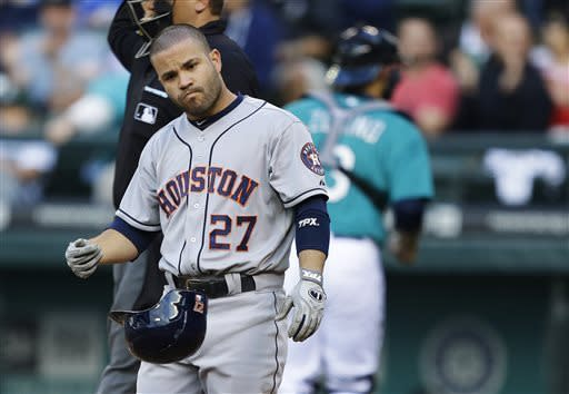 Houston Astros' Jose Altuve tosses his helmet after being called out on strikes in the third inning of a baseball game against the Seattle Mariners, Wednesday, June 12, 2013, in Seattle. (AP Photo/Ted S. Warren)