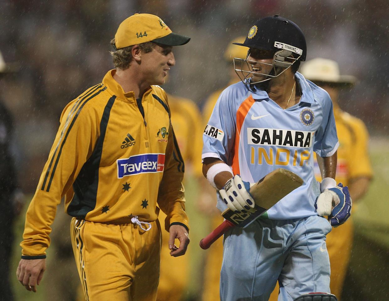 BANGALORE, INDIA - SEPTEMBER 29:  Brad Haddin of Australia and Gautam Gambhir of India share a laugh as they leave the field as rain halts play during the first One Day International between India and Australia at M. Chinnaswamy Stadium on September 29, 2007 in Bangalore, India.  (Photo by Hamish Blair/Getty Images)