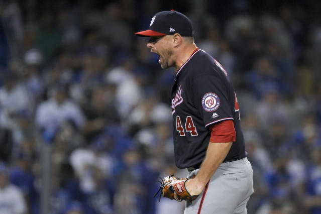 Washington Nationals relief pitcher Daniel Hudson celebrates after the final out in Game 2 of the baseball team's National League Division Series against the Los Angeles Dodgers on Friday, Oct. 4, 2019, in Los Angeles. The Nationals won 4-2. (AP Photo/Mark J. Terrill)
