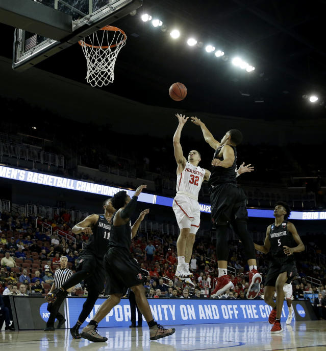 Houston guard Rob Gray (32) puts up a shot during the first half of an NCAA men's college basketball tournament first-round game against San Diego State Thursday, March 15, 2018, in Wichita, Kan. (AP Photo/Charlie Riedel)