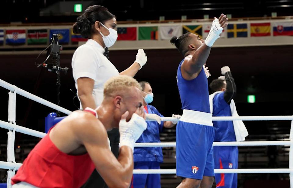 Ben Whittaker (left) and Arlen López react to the judge's decision in the gold-medal bout.