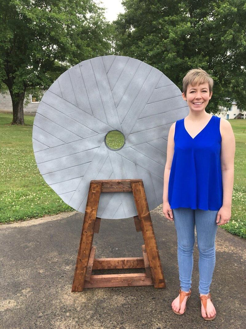 "Rev. Ashley Easter stands next to a fake millstone that will be displayed Tuesday at the ""For Such a Time as This"" rally outside the Birmingham-Jefferson Convention Center in Alabama. It represents Jesus' warning about people who harm children. (Photo: For Such A Time As This Rally)"