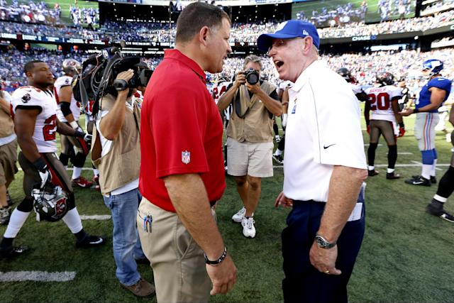 Greg Schiano (L) got an earful from Tom Coughlin in 2012 after a heated conclusion to a Bucs-Giants game in which Tampa blew up New York's victory formation. (AP)
