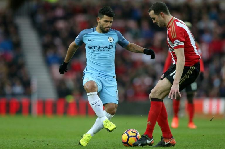 Manchester City's striker Sergio Aguero (L) vies with Sunderland's defender John O'Shea during the English Premier League football match between Sunderland and Manchester City at the Stadium of Light in Sunderland, north-east England on March 5, 2017
