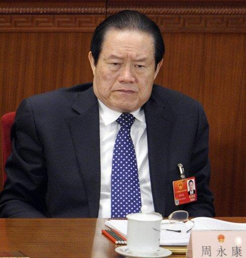 Zhou Yongkang, a member of the Standing Committee of the Political Bureau of CPC attends the opening session of the National People's Congress (NPC) at the Great Hall of the People in Beijing on March 5. China has shut down websites, made a string of arrests and punished two popular microblogs after rumours of a coup in Beijing linked to a major scandal that brought down a top politician