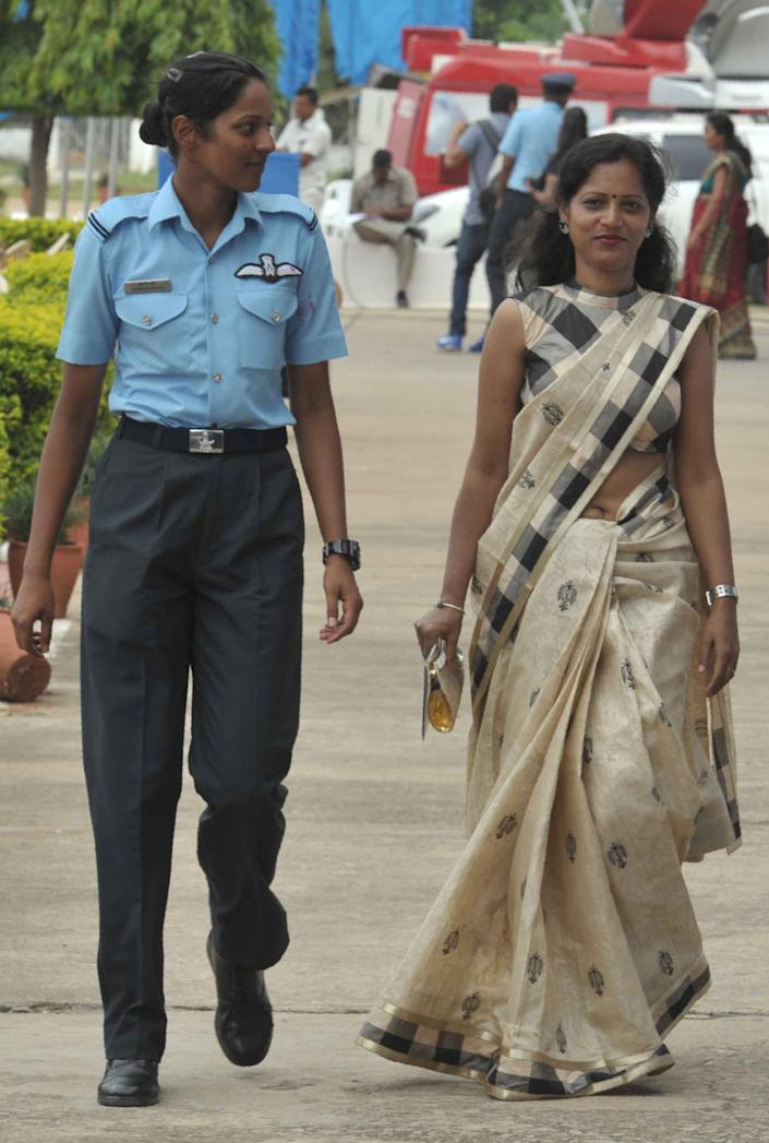Indian Indian Air Force Acedemy (IAF) fighter pilot Bhawana Kanth (L) walks with her mother Radha Kanth after the combined graduation parade at the air force academy at Dundigal in Hyderabad on June 18, 2016. The first three women fighter pilots of the Indian Air Force have been conferred with the President's commission, and 22 women trainees were commissioned as flying officers from the Air Force Academy. / AFP / NOAH SEELAM        (Photo credit should read NOAH SEELAM/AFP via Getty Images)