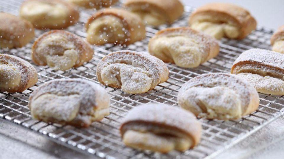"""<p>Though these cheese pastries are a <a href=""""https://www.thedailymeal.com/holidays/hanukkah-foods?referrer=yahoo&category=beauty_food&include_utm=1&utm_medium=referral&utm_source=yahoo&utm_campaign=feed"""" rel=""""nofollow noopener"""" target=""""_blank"""" data-ylk=""""slk:traditional recipe for Hanukkah"""" class=""""link rapid-noclick-resp"""">traditional recipe for Hanukkah</a>, the delicious sweet baked goods use farmer cheese in the dough and the filling, for good measure and good tidings.</p> <p><a href=""""https://www.thedailymeal.com/best-recipes/judiths-cheese-pastries?referrer=yahoo&category=beauty_food&include_utm=1&utm_medium=referral&utm_source=yahoo&utm_campaign=feed"""" rel=""""nofollow noopener"""" target=""""_blank"""" data-ylk=""""slk:For the Judith's Cheese Pastries recipe, click here."""" class=""""link rapid-noclick-resp"""">For the Judith's Cheese Pastries recipe, click here.</a></p>"""