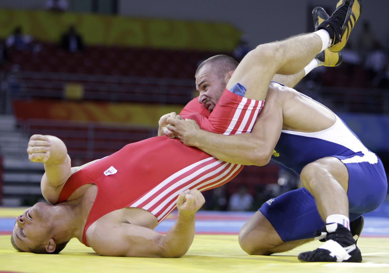 Russia's Aslanbek Khushtov wrestles Czech Republic's Marek Svec in the semi-finals of the men's 96 kg Greco-Roman wrestling at the 2008 Olympics in Beijing, Thursday, Aug. 14, 2008. Khushtov won the match to advance to the finals. (AP Photo/David Guttenfelder)