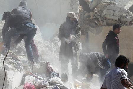 At least 40 killed in twin bombing at Damascus cemetery