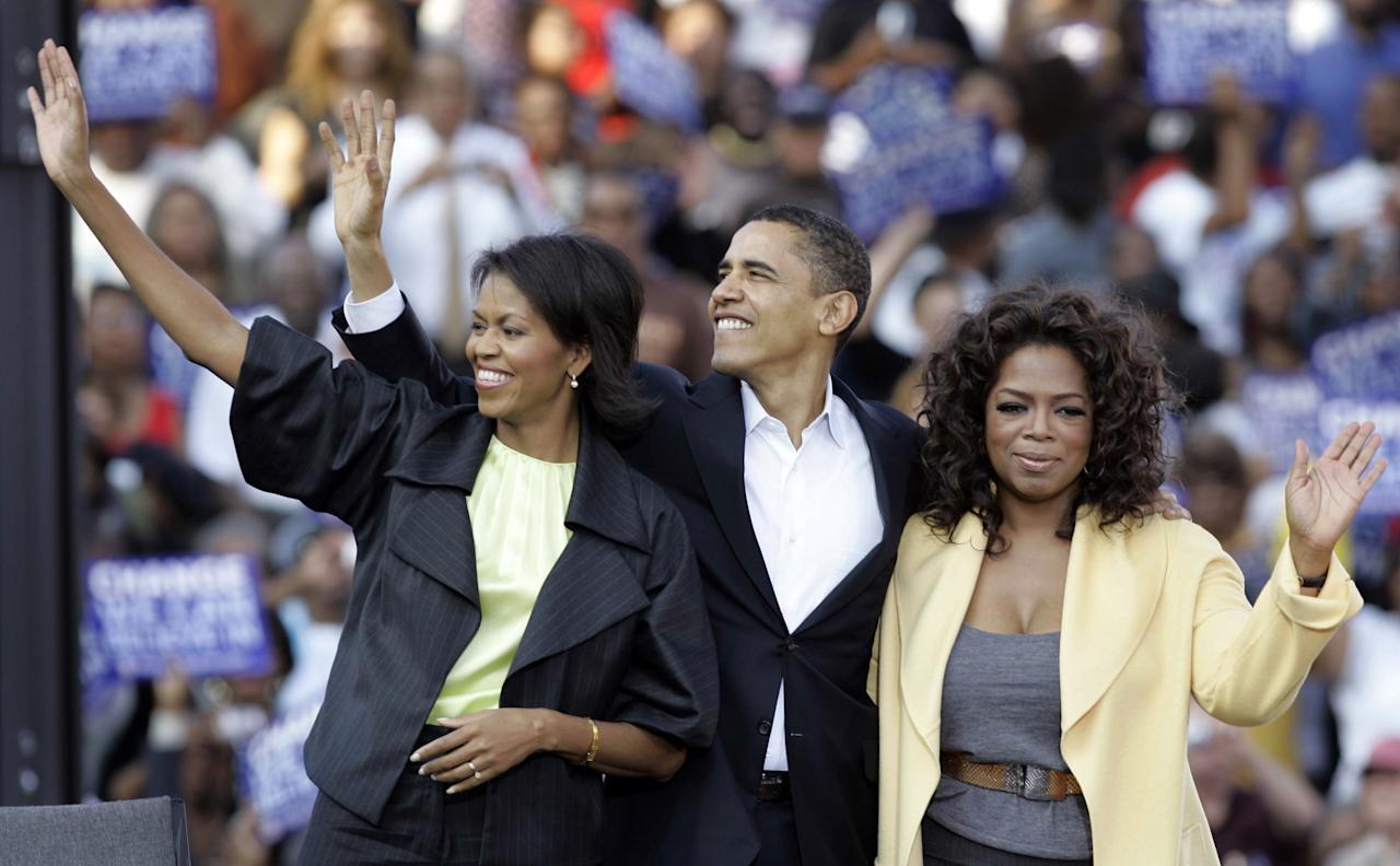 FILE - in this Dec. 9, 2008 file photo, then-Democratic presidential hopeful, Sen. Barack Obama,D-Ill., with his wife Michelle, left, and talk-show diva Oprah Winfrey, right, take part in a campaign rally in Columbia, S.C. The president's re-election campaign is increasingly sounding like a nostalgia tour. His speeches stroll through elections past, serving up fond memories of his days running as a political unknown, identifying early political inspirations and reminding voters that, win or lose, this will be his last campaign after 13 appearances on the ballot since 1996. (AP Photo/Mary Ann Chastain, File)