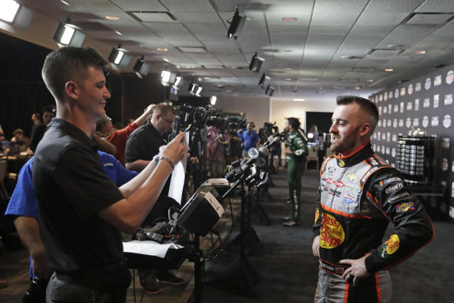 Austin Dillon, right, takes part in an interview during NASCAR Daytona 500 auto racing media day at Daytona International Speedway, Wednesday, Feb. 12, 2020, in Daytona Beach, Fla. (AP Photo/John Raoux)