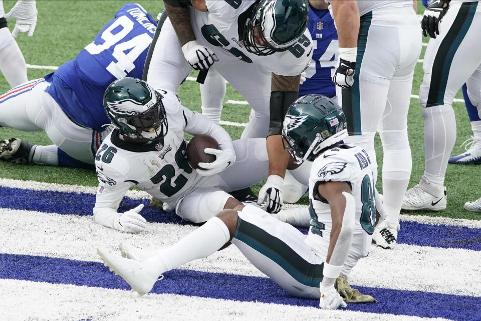 Philadelphia Eagles' Miles Sanders (26) scores a two-point conversion during the second half of an NFL football game against the New York Giants, Sunday, Nov. 15, 2020, in East Rutherford, N.J. (AP Photo/Seth Wenig)