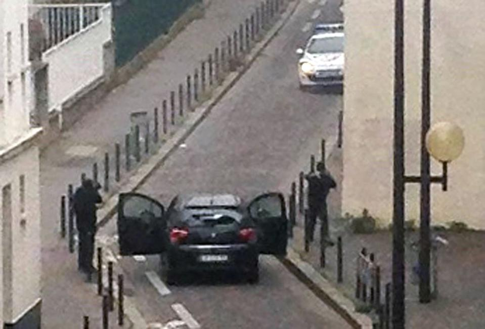 "<div class=""inline-image__caption""><p>Armed gunmen face police officers near the offices of the French satirical newspaper Charlie Hebdo in Paris on January 7, 2015, during an attack on the offices of the newspaper which left eleven dead, including two police officers, according to sources close to the investigation. </p></div> <div class=""inline-image__credit"">Anne Gelbard/Getty</div>"