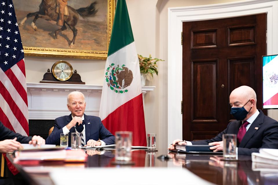 Joe Biden, left, and Homeland Security Secretary Alejandro Mayorkas attending a virtual meeting with their Mexican counterparts on Monday. (Getty Images)