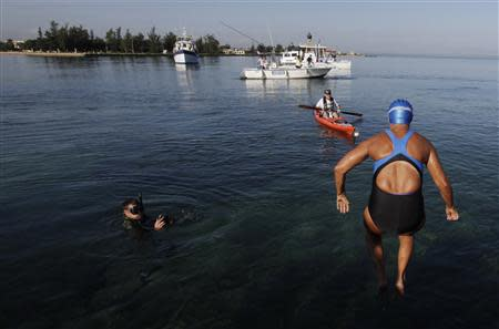 U.S. long-distance swimmer Diana Nyad jumps into the waters of Havana's Hemingway Marina August 31, 2013. REUTERS/Enrique De La Osa