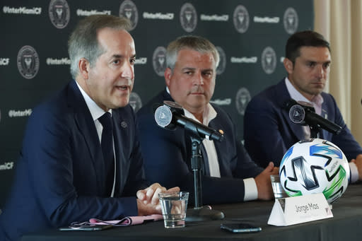 Inter Miami CF MLS soccer team managing owner Jorge Mas, left, speaks during an interview introducing head coach Diego Alonso, right, as sporting director Paul McDonough, center, looks on during a news conference, Wednesday, Jan. 22, 2020, in Key Biscayne, Fla. (AP Photo/Wilfredo Lee)q