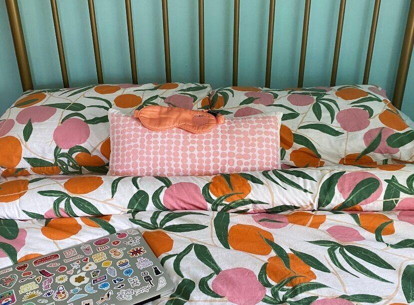 "All's well with Allswell: It's the best mattress I've ever had. I paired it with <a href=""https://fave.co/2YEgiDU"" target=""_blank"" rel=""noopener noreferrer"">peach printed sheets</a>, a matching <a href=""https://fave.co/2YF0MHX"" target=""_blank"" rel=""noopener noreferrer"">duvet set</a> and a <a href=""https://fave.co/35hylnn"" target=""_blank"" rel=""noopener noreferrer"">silk sleeping mask</a> for a good night's sleep. (Photo: Ambar Pardilla / HuffPost Finds)"