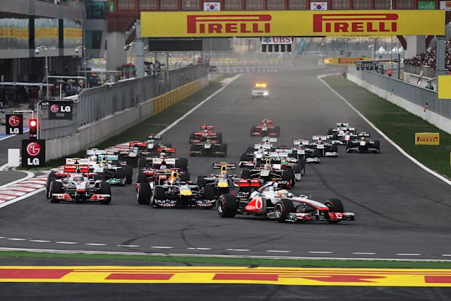 YEONGAM-GUN, SOUTH KOREA - OCTOBER 16: Lewis Hamilton of Great Britain and McLaren leads the fied into the first corner on the first lap of the Korean Formula One Grand Prix at the Korea International Circuit on October 16, 2011 in Yeongam-gun, South Korea. (Photo by Mark Thompson/Getty Images)