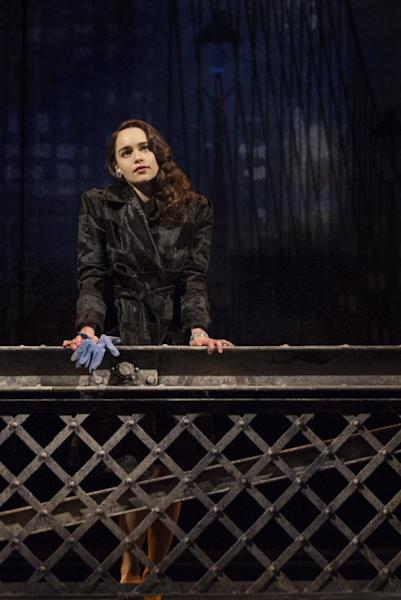 """This theater image released by The O+M Company shows Emilia Clarke as Holly Golightly in a scene from """"Breakfast at Tiffany's,"""" performing at the Cort Theatre in New York. Clarke's costumes were designed by three-time Academy Award-winning costume designer Colleen Atwood. (AP Photo/The O+M Company, Nathan Johnson Photography)"""