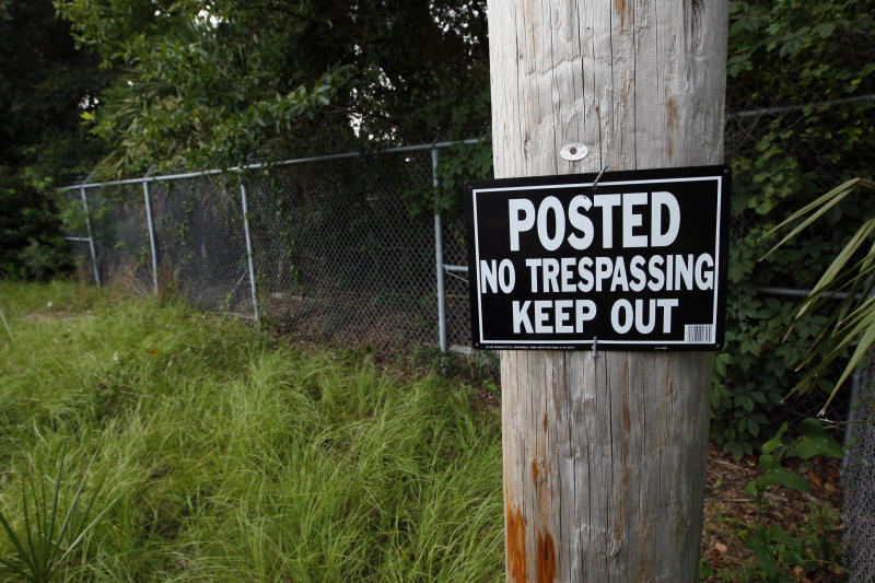 This is a July 31, 2012 photograph of a half-acre plot adjacent to the former President Broadwater Beach Golf Club in Biloxi, Miss., that the Harrison County Utility Authority spent $457,000 to buy in order to locate a new water tank even though the land's former use as an electrical transformer site raised questions about whether the parcel was contaminated. Federal authorities are auditing the use of more than $650 million in grants designated for an ambitious plan for sewage and water systems across south Mississippi in the wake of Hurricane Katrina and the purchase is among projects being audited by HUD. (AP Photo/Rogelio V. Solis)