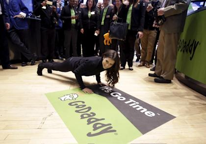 NASCAR driver Danica Patrick does pushups on the floor of the New York Stock Exchange, as her sponsor GoDaddy makes its initial public offering, in New York, April 1, 2015. REUTERS/Brendan McDermid