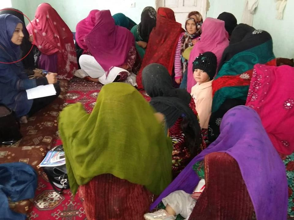 The work that Nelofar Akbari (circled left) did to teach Afghan village women about their legal rights put her on the wrong side of the Taliban. (Nelofar Akbari - image credit)