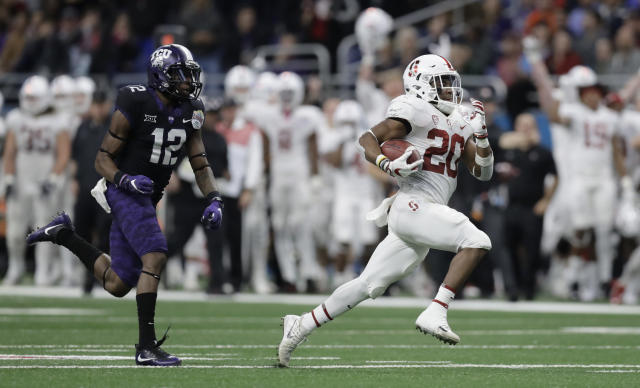 "Stanford running back <a class=""link rapid-noclick-resp"" href=""/ncaaf/players/257525/"" data-ylk=""slk:Bryce Love"">Bryce Love</a> (20) is the early favorite to win the 2018 Heisman Trophy. (AP Photo/Eric Gay)"