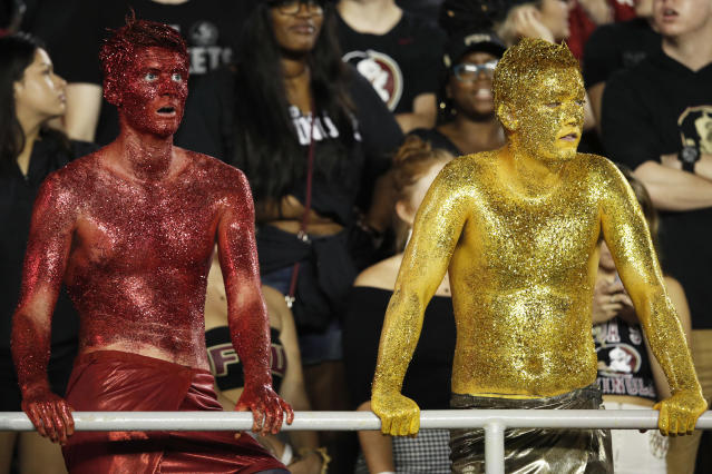 Imagine putting all this glitter on yourself, just to see Florida State lose. (Getty Images)