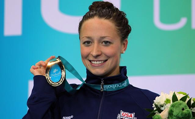 Ariana Kukors poses with her gold medal after winning the Women's 100-meter Individual Medley final of the 10th FINA World Swimming Championships in 2010 in Dubai, United Arab Emirates.