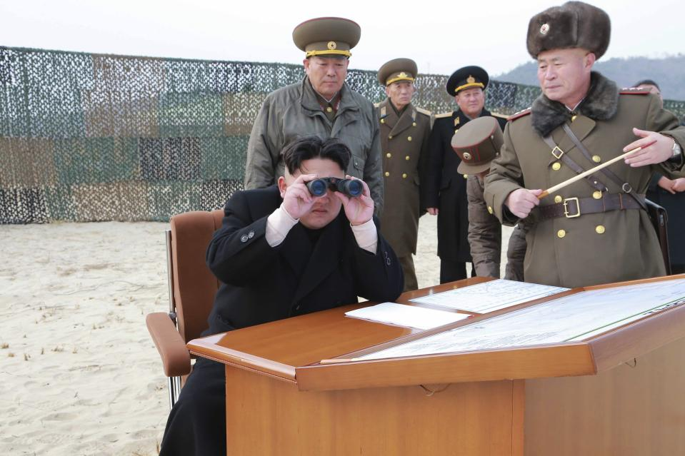 North Korean leader Kim Jong Un looks through a pair of binoculars as he guides the multiple-rocket launching drill of women's sub-units under KPA Unit 851, in this undated photo released by North Korea's Korean Central News Agency (KCNA) in Pyongyang December 30, 2014. REUTERS/KCNA (NORTH KOREA - Tags: POLITICS) ATTENTION EDITORS - THIS PICTURE WAS PROVIDED BY A THIRD PARTY. REUTERS IS UNABLE TO INDEPENDENTLY VERIFY THE AUTHENTICITY, CONTENT, LOCATION OR DATE OF THIS IMAGE. FOR EDITORIAL USE ONLY. NOT FOR SALE FOR MARKETING OR ADVERTISING CAMPAIGNS. THIS PICTURE IS DISTRIBUTED EXACTLY AS RECEIVED BY REUTERS, AS A SERVICE TO CLIENTS. NO THIRD PARTY SALES. NOT FOR USE BY REUTERS THIRD PARTY DISTRIBUTORS. SOUTH KOREA OUT. NO COMMERCIAL OR EDITORIAL SALES IN SOUTH KOREA